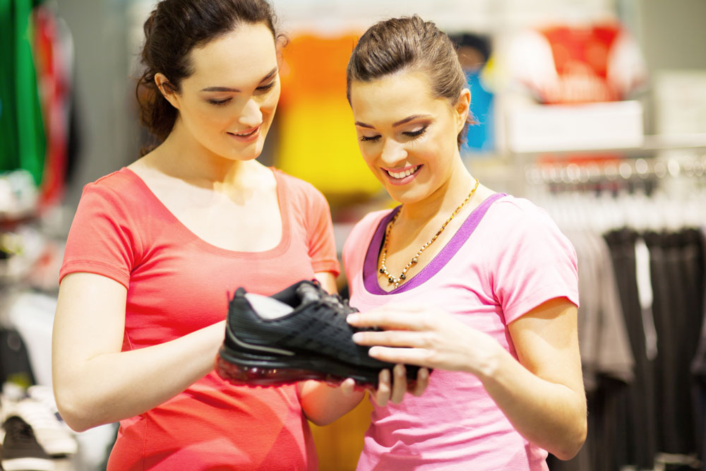 women looking at shoes