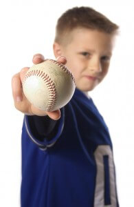 boy holding out a baseball